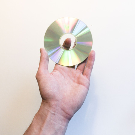 Hand holding a disk