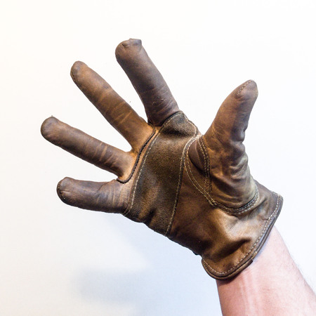 Hand in leather glove 版權商用圖片