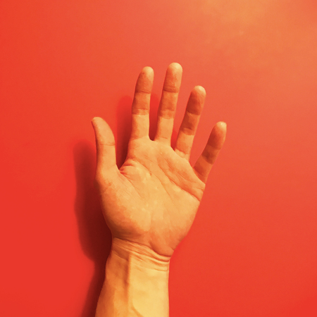 Hand on red