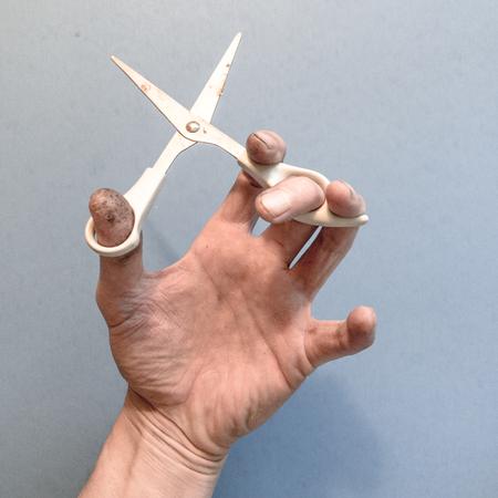 Hand holding scissors