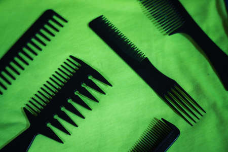 Hairbrushes for styling and hair cuts on a green background. Фото со стока - 95659708