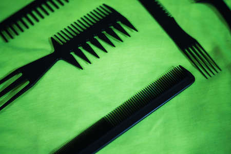 Hairbrushes for styling and hair cuts on a green background. Фото со стока - 95659710