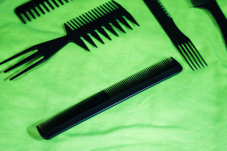 Hairbrushes for styling and hair cuts on a green background. Фото со стока - 95659672