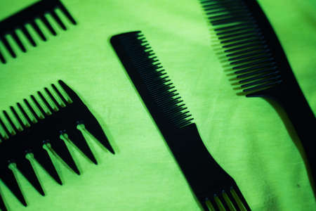 Hairbrushes for styling and hair cuts on a green background. Фото со стока - 95659675
