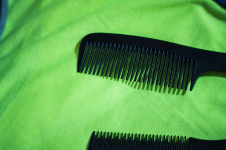 Hairbrushes for styling and hair cuts on a green background. Фото со стока - 95659676