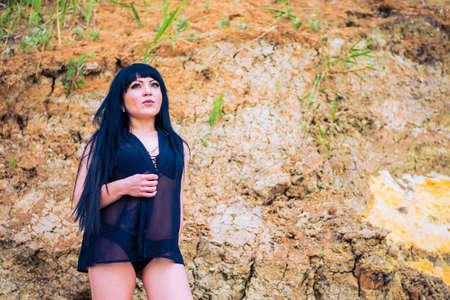 Brunette girl in a naked body on the beach