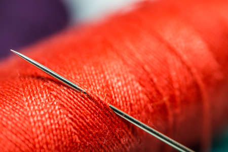 Coil with a red cotton thread