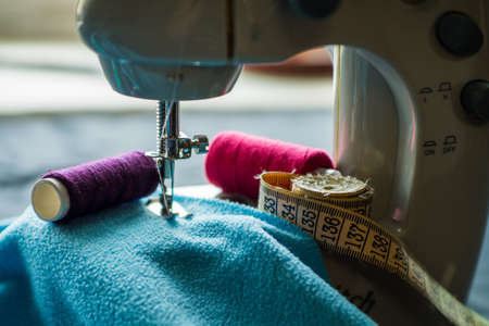 Sewing machine sews fabric