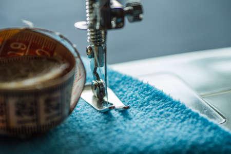 Sewing machine sews fabric 스톡 콘텐츠 - 128505141