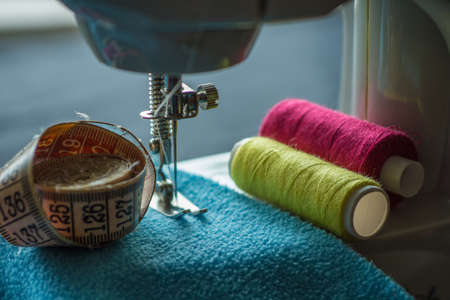 Sewing machine sews fabric
