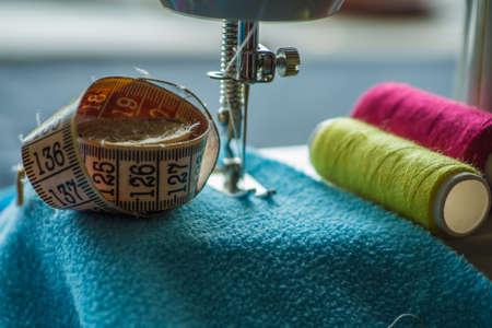 Sewing machine sews fabric 스톡 콘텐츠 - 128505140