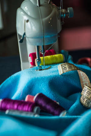 Sewing machine sews fabric 스톡 콘텐츠 - 128505187