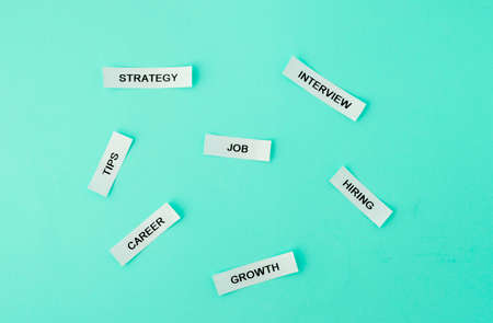job, strategy, tips, career, interview, growth, hiring words on white sticky notes on blue green background. Horizontal, business, career, employement concept Stock Photo