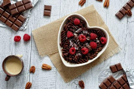 Cocoa pasta with white chocolate sauce photo
