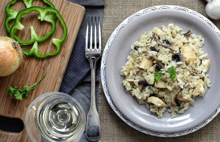 mushrooms: Risotto with chicken and mushrooms on a grey plate Stock Photo