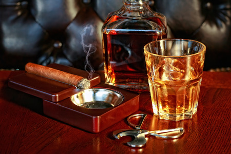 drinks after work: Whiskey and cigar Stock Photo