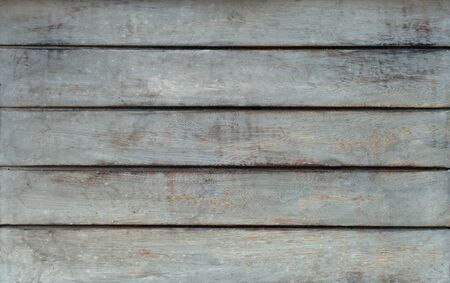 Horizontal grey rustic wooden table texture taken from the top. Reklamní fotografie