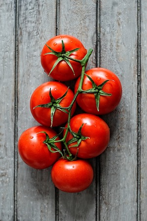 Group of ripe tomatoes on a rustic wooden table. View from above Reklamní fotografie