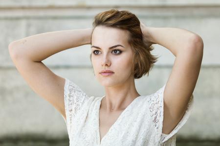 Beautiful girl in white summer dress