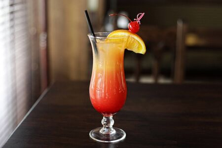 A glass of tequila sunrise cocktail
