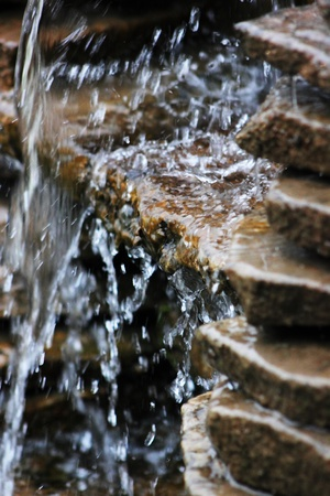 Water flowing down on stone. Waterfall.
