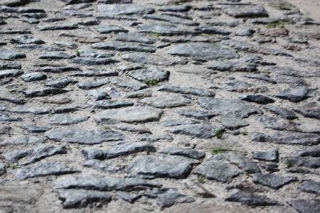 surface of vintage stone road at old street