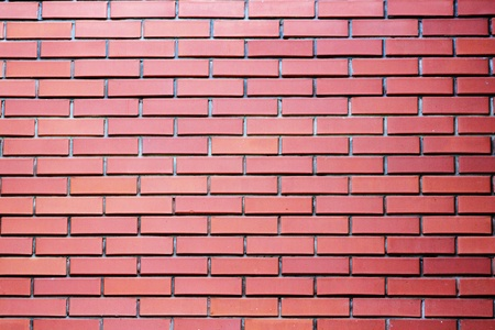 Red brick wall with textured bricks