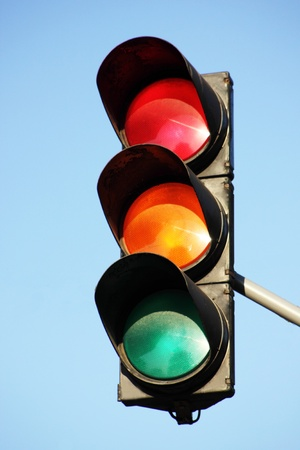 Traffic control signals against the blue sky