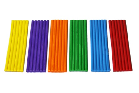 row of colorful plasticine on white background