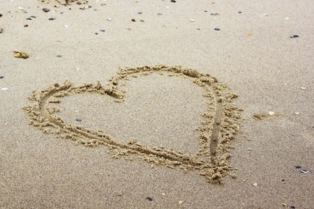 Heart painted in the sand symbol of love