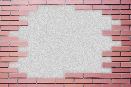 Grungy parchment paper background surrounded by red brick frame isolated