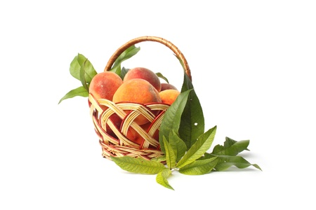 stock photos: peaches in a basket isolated on white