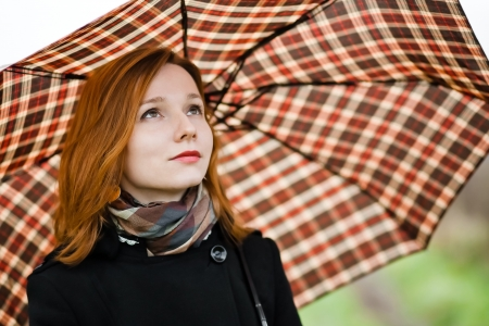 portrait of beautiful girl with chequered umbrella