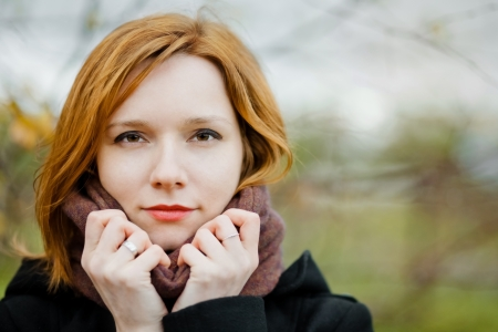 portrait of beautiful girl on a cold autumn day photo