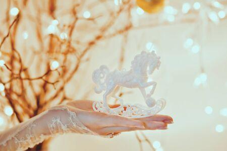 Christmas Rocking Horse Ornament with beautiful magic lighting, toned photo. Stock Photo