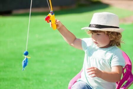 Adorable little girl toy fishing, having fun, activity for little children