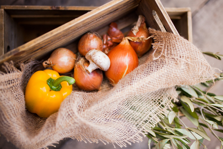 Vegetables prepared for cooking, pepper, pepper, mushroom and onion rustic style, wooden box, farmer market