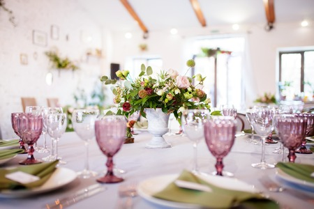 wedding banquet, loft style, served tables with flowers and lots of greenery