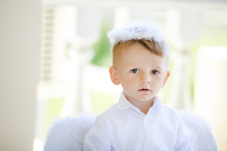 Adorable toddler boy in angel costume, angelic child. Saint Valentines day.