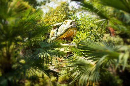 Entrance to the dinosaur park, gigantic tyrannosaurus model Reklamní fotografie