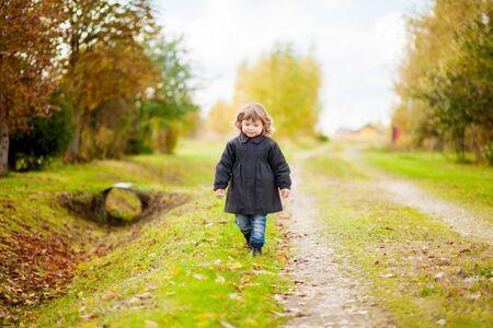 Caucasian toddler girl, wearing black coat. 版權商用圖片