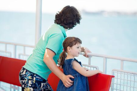 Dad and daughter are sailing on a boat on the river at summer. Family of tourists on excursions. Archivio Fotografico