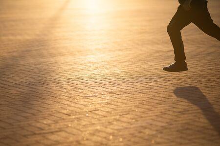Little boy running down the street in the city at sunset, sport and avtivity for kids 版權商用圖片