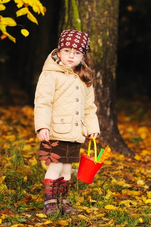 full lenght: Full lenght portrait of adorable toddler girl in autumn forest