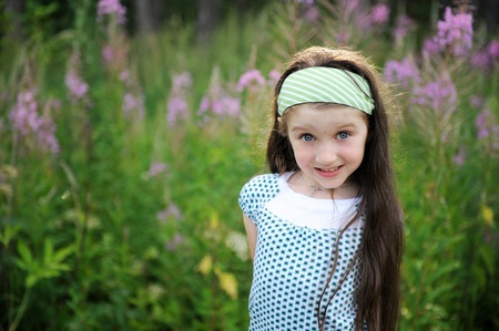 Outdoors portrait of adorable amazed blue-eyed child girl Stock Photo