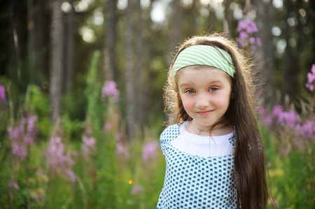 headband: Outdoors portrait of adorable amazed blue-eyed child girl Stock Photo