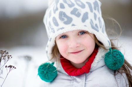blue eyed: Winter portrait of adorable happy child girl in warm clothes