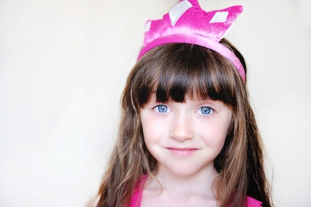 Portrait of beautiful little girl in pink tiara, isolated Stock Photo