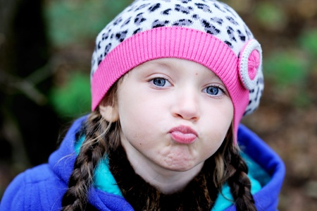 open lips: Outdoor portrait of funky little girl in leopard beret