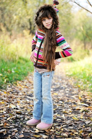 blue jeans kids: Full length portrait of funky child girl in jeans and colorful blouse